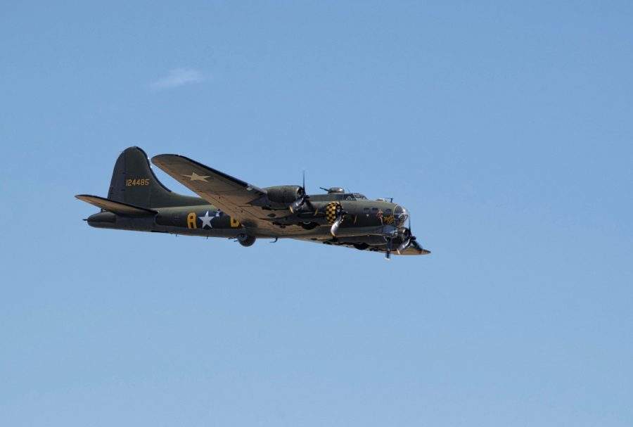 B-17 bomber in blue sky background