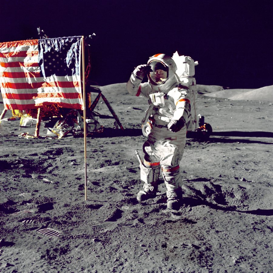 Astronaut on Moon Saluting Flag